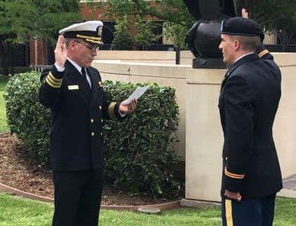 Brian Foy swears in his youngest son Connor as an Army 2nd Lieutenant
